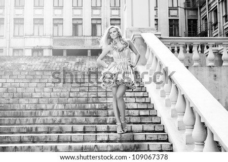 Beautiful Young woman walking on the streets of old european city. Outdoors - stock photo