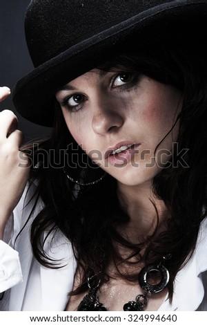 Beautiful young woman wearing black hat - stock photo