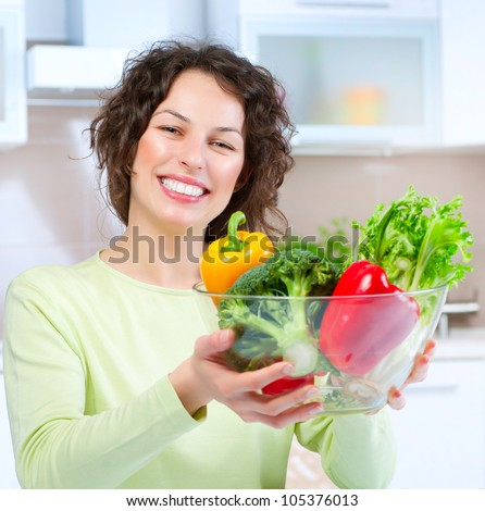 Beautiful Young Woman  with healthy food. Vegetables. Dieting concept .Diet.