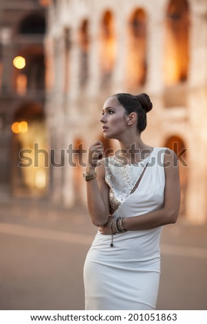 Beauty woman at night with coloseum in background
