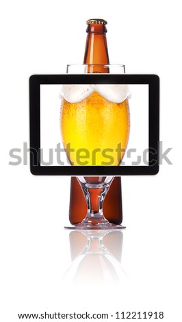 beer glass and bottle on tablet computer screen  isolated on a white background - stock photo
