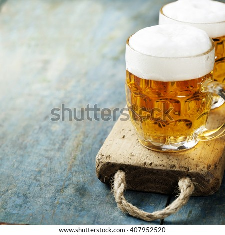 beer on wood background with copyspace - stock photo