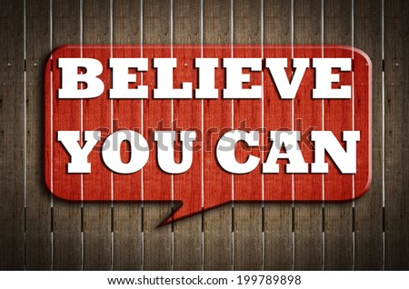 """ Believe you can  "" on red speech bubble wood on wood background - stock photo"