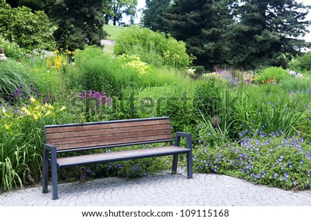 bench to rest in a beautiful park - stock photo