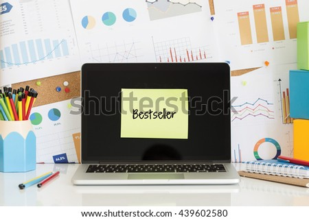 BESTSELLER sticky note pasted on the laptop screen - stock photo