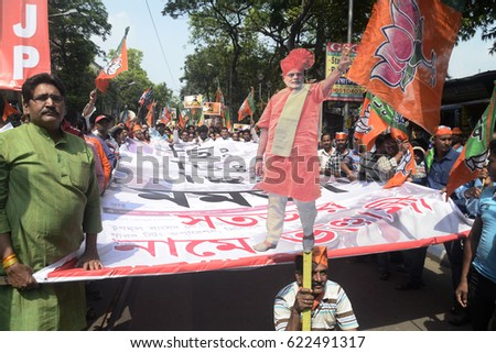 Bharatiya Janta Party activist hold cut out of Prime Minister Narendra Modi during a rally protesting against financial scam of West Bengal ruling party leaders on March 22, 2017 in Calcutta, India.