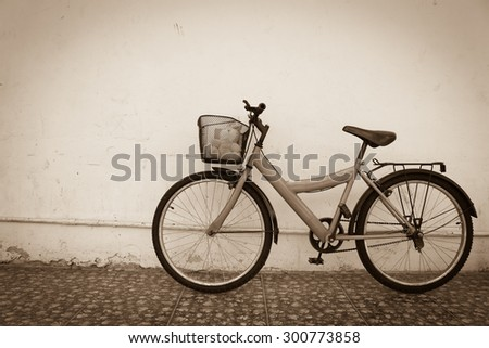 bicycle on old dirty  house wall,old vintage style.