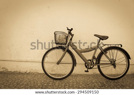 bicycle on old dirty  house wall,vintage style.