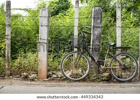 bicycle with rust barbed wire