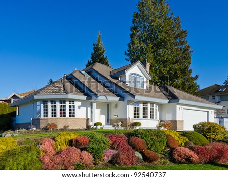 Big luxury house  in a sunny  day - stock photo