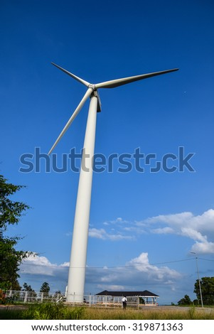 big wind turbine and a blue sky
