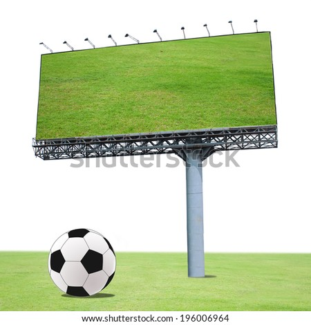 billboard and football on the green field . Useful for your advertisement - stock photo