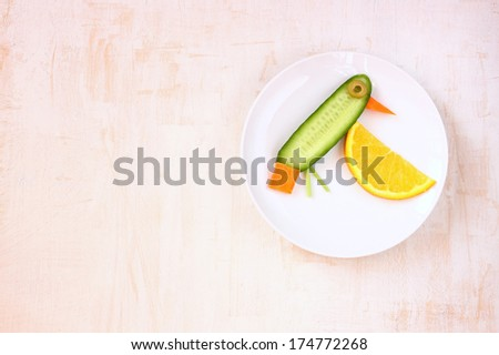 bird made of vegetables and fruit . Creative design in order to encourage children to eat vegetables and fruit  - stock photo