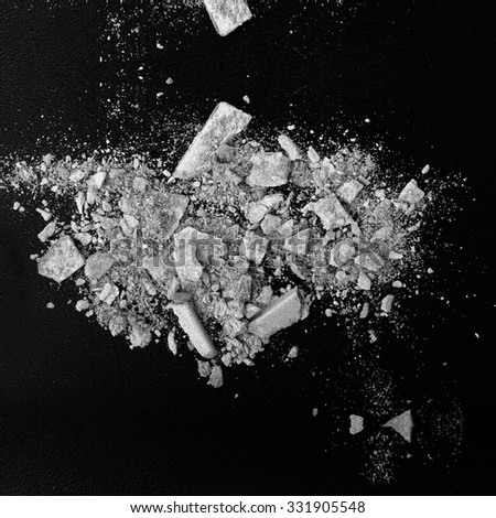 Black and white abstract background with powder. Crushed eyeshadow on black background.  - stock photo