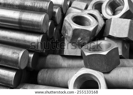 Black and white image of screws and bolts pile