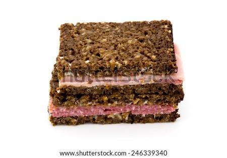 Black dark bread Sandwiches with Ham and Salami - specific German healthy whole corn bread Sandwiches - stock photo