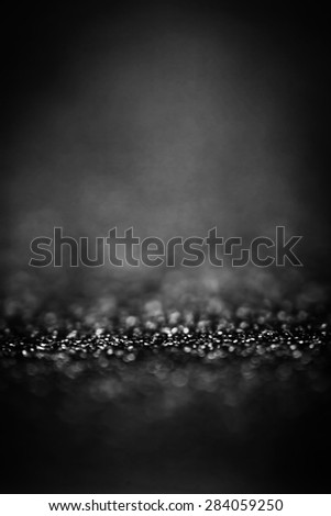 Black Festive Abstract background. Christmas twinkled bright background with bokeh defocused white and silver  lights. Magic texture  - stock photo