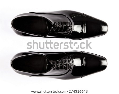 Black patent leather men shoes against white background  - stock photo