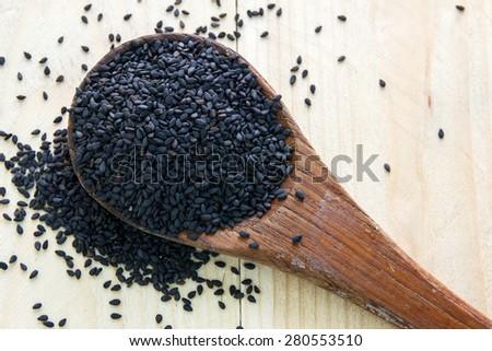 black sesame on wood spoon - stock photo