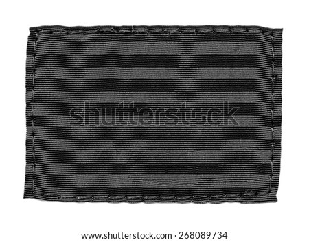 black textile label on white background, pure label for your text. - stock photo