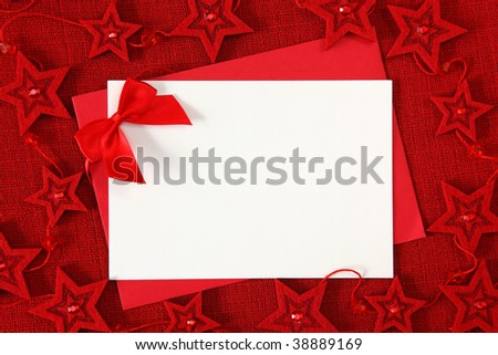 Blank card with bow on red background