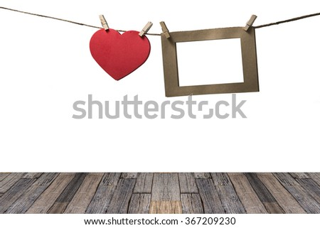 blank instant photos hanging on the clothesline with red heart - stock photo