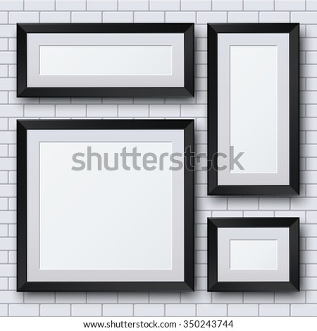 blank picture frame set on brick wall. Template background - stock photo