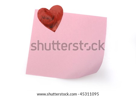 blank pink note with heart magnet - stock photo