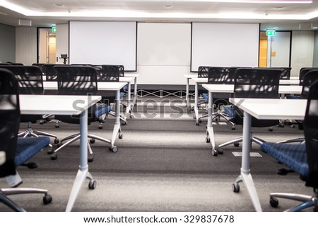 2 Blank screen for slide projector show  in meeting room - stock photo