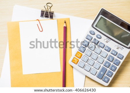 blank white paper, pencil and calculator on desk - stock photo