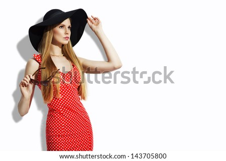 Blonde girl in retro style with big hat on white background - stock photo