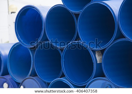 Blue barrels on a chemical plant Texture background - stock photo