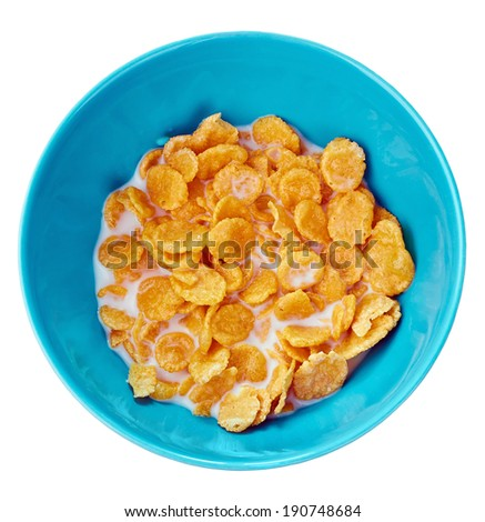 Blue bowl of corn flakes ,  top view, isolated on a  white  - stock photo