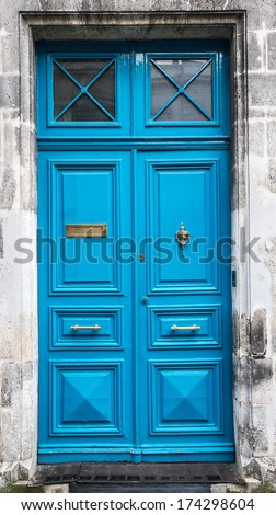 blue old wooden door in Angouleme, France - stock photo