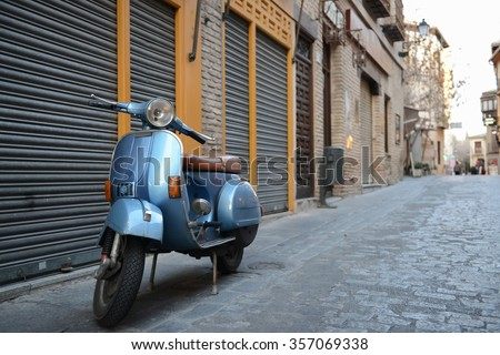 Blue vintage Vespa in old street - stock photo