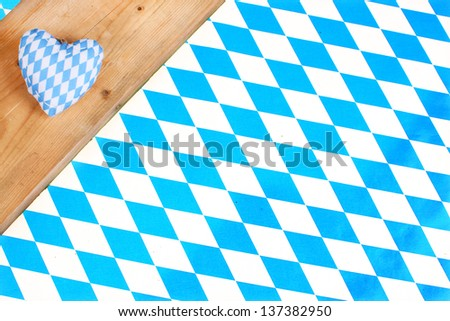 Blue white bavarian heart on checkered background - stock photo