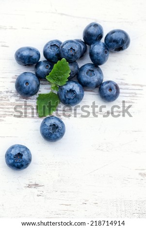 Blueberries on wooden background, top view - stock photo