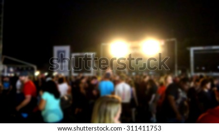 blur background of people at outdoor music festival