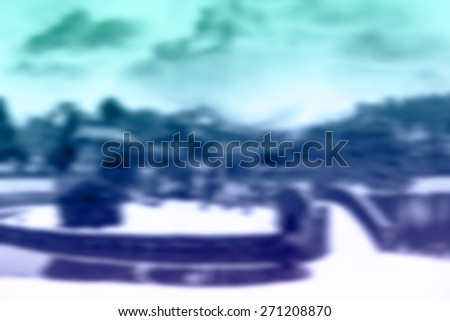(BLUR style Abstract background) Snow covered temple on a pond, Nigata Prefecture. - stock photo