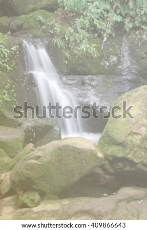 blur waterfall background with ray light