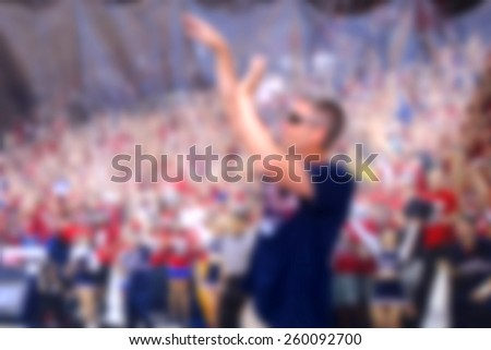 blurred background of basketball player shooting ball                      - stock photo