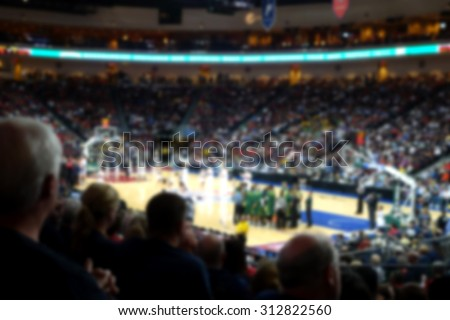 blurred background of sports arena crowd                               - stock photo