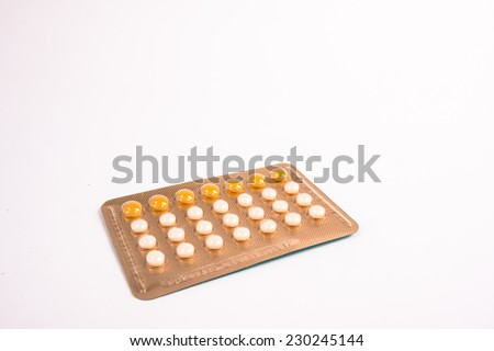 blurred , Birth control pills on white background,vintage color tone .  - stock photo
