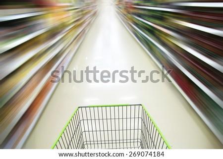 blurred supermarket cart. - stock photo