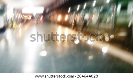Blurred train and people movement in railway station at night for background - stock photo