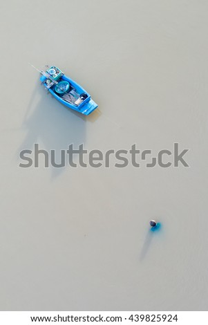 Boat floating in the river - stock photo