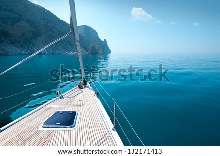boat floats near the shore. Luxury Lifestyle