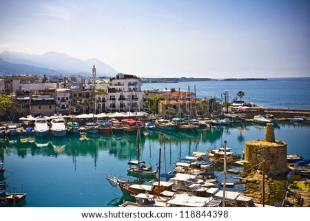 boats and houses and reflections Marina of Kyrenia in Northern Cyprus - stock photo