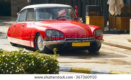BODRUM / TURKEY �  22 JANUARY 2016: Classic Vintage Luxury red car  Citroen DS standing in front of entrance to the luxury restaurant at summer located at Palmarina in Bodrum Turkey - stock photo