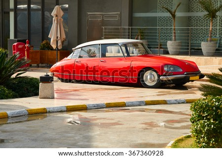 BODRUM / TURKEY �  22 JANUARY 2016: Classic Vintage Red Citroen DS standing in front of luxury restaurant in Palmarina in Turkey - stock photo